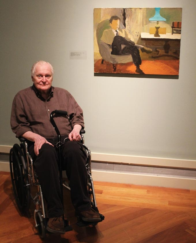 Poet John Ashbery poses in front of a Fairfield Porter painting for which he was the sitter