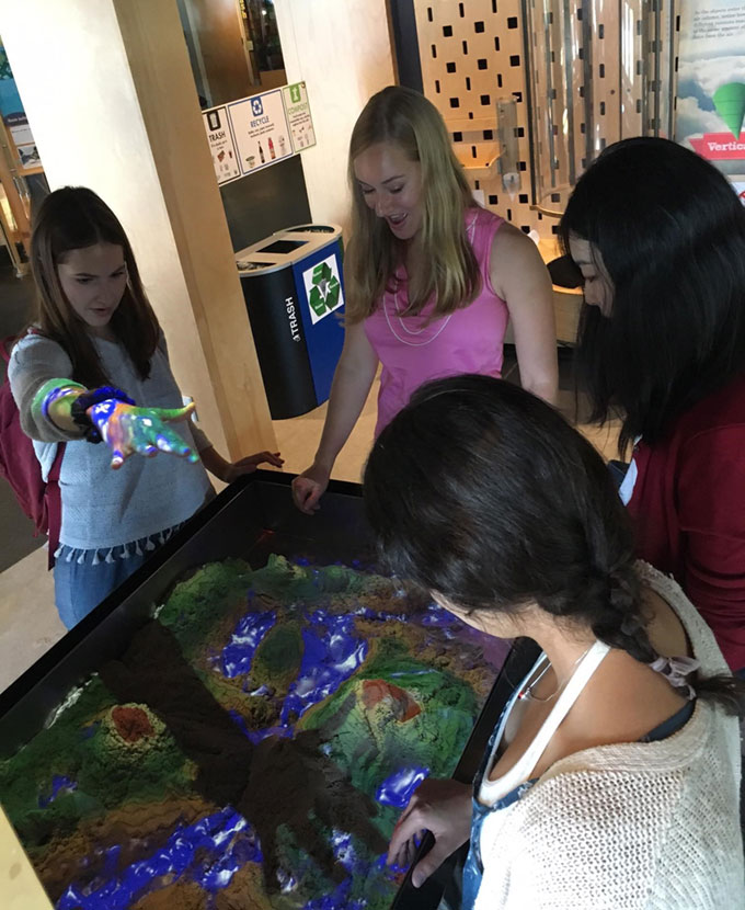 2018 MuseumWorks interns enjoy an interactive science exhibit at the ECHO Leahy Center