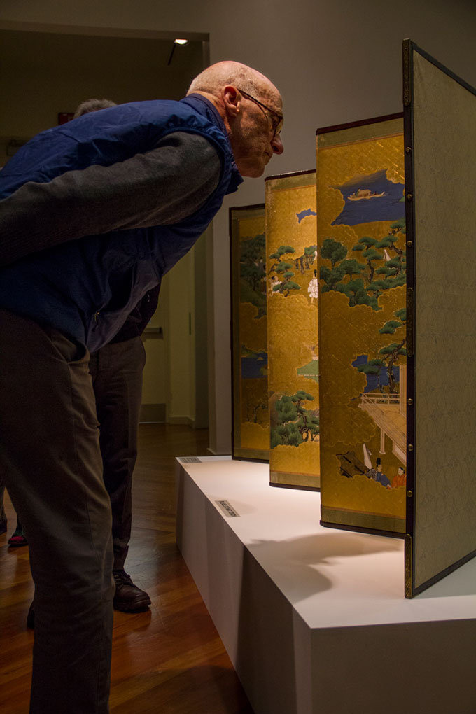A member of the Friends of the Art Museum examines a possible purchase