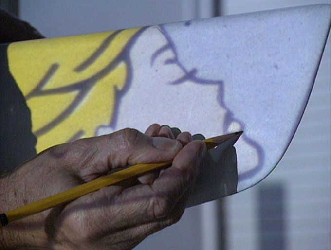 Roy Lichtenstein at work on the design for Young America